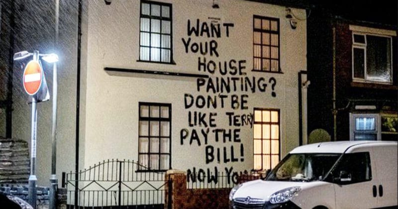 Decorator paints angry message on front of house after not being paid, The Manc