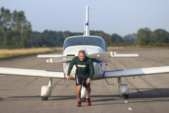 Kickboxing champion from Stockport completes marathon pulling a plane for charity, The Manc