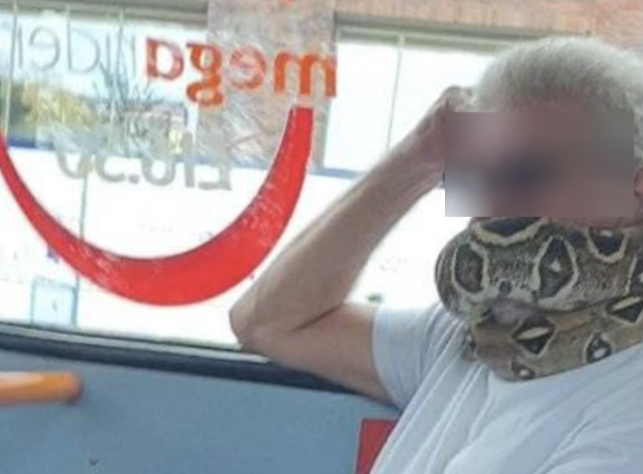 A man has been spotted using a snake as a face covering on a bus in Salford, The Manc