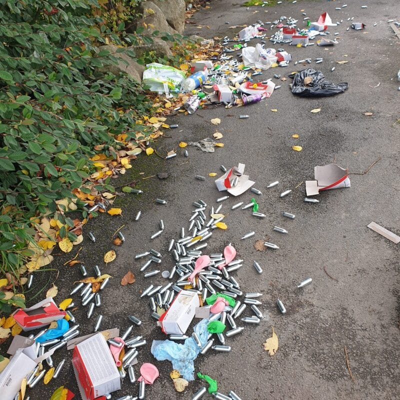Hundreds of 'laughing gas' canisters found littered across Salford street, The Manc