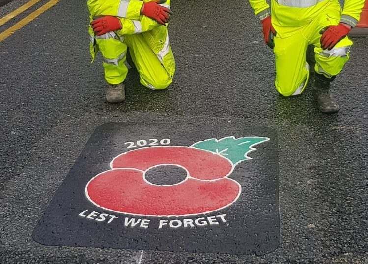 'Lest We Forget' poppy road signs are being painted near war memorials across Bolton, The Manc