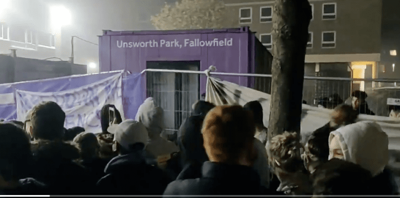 Students tear down fences at Manchester University halls during mass protest against being 'imprisoned' on Bonfire Night, The Manc