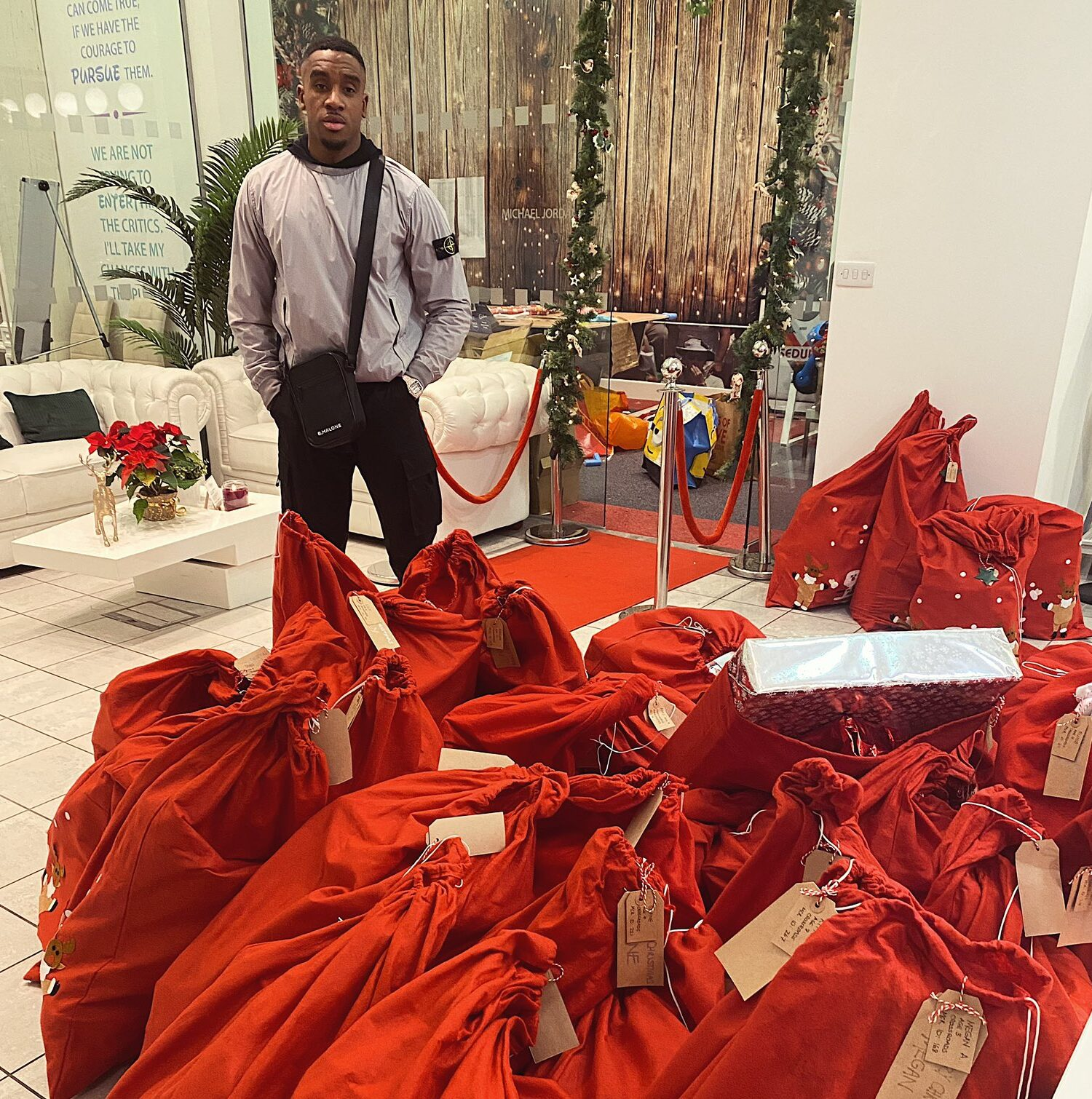 Manchester rapper Bugzy Malone donates sacks full of Christmas presents to 'underprivileged children', The Manc