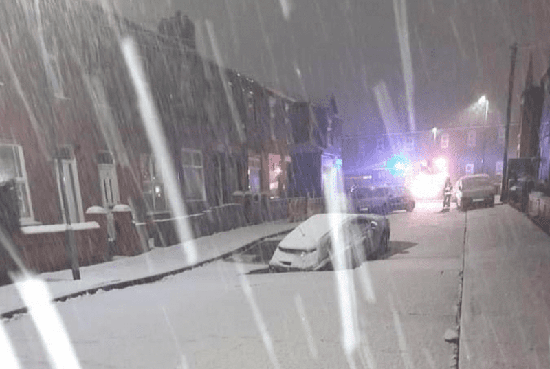 Huge sinkhole swallows car in Abbey Hey after surprise snow blankets Manchester, The Manc