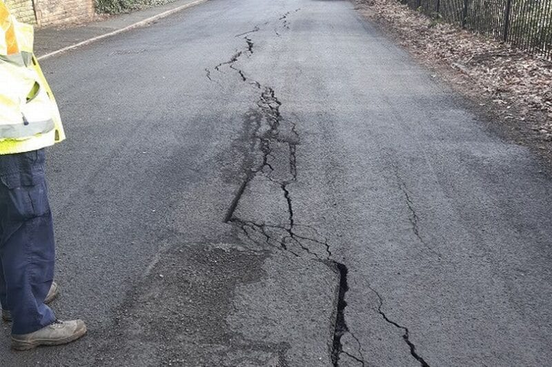 A Salford road has been closed after mysterious cracks emerged and it 'partially collapsed', The Manc