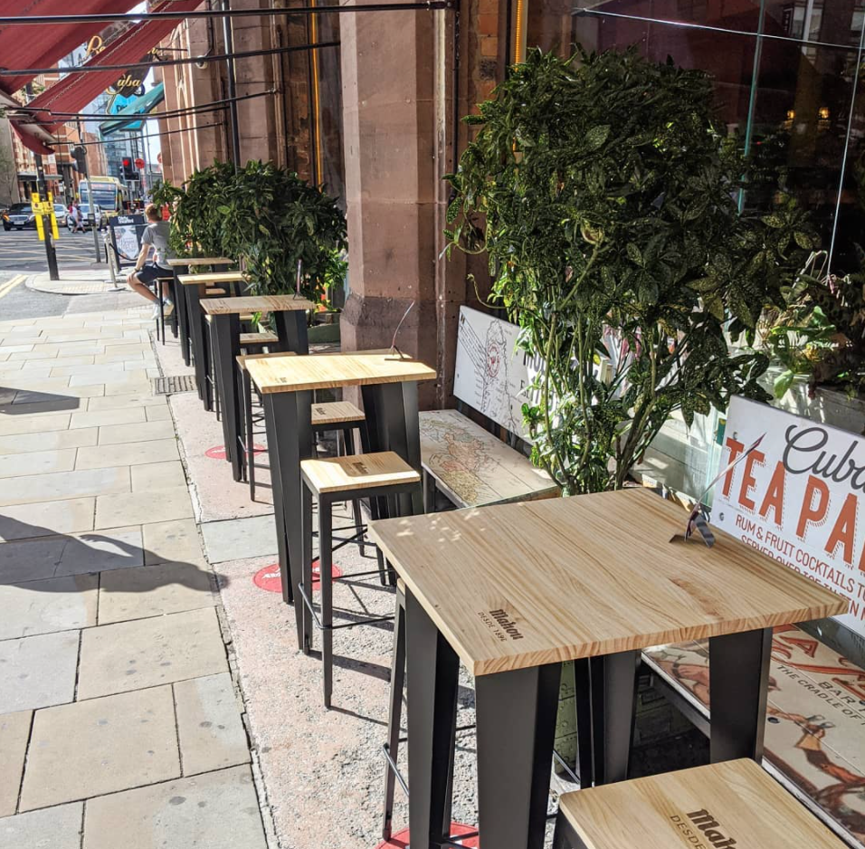 A couple have been given the bench they met on at a Manchester bar three years ago for their flat, The Manc