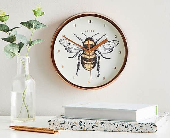 Tesco is selling a gold bee wall clock for only £8 and it's perfect for your Manc home, The Manc
