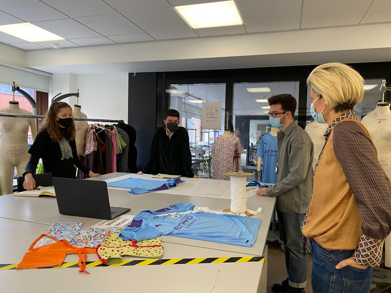MMU students and staff create children's hospital gowns from donated football shirts, The Manc