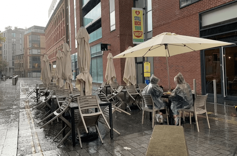 Ancoats pair become icons after photo of them enjoying lunch in torrential rain and hail goes viral, The Manc