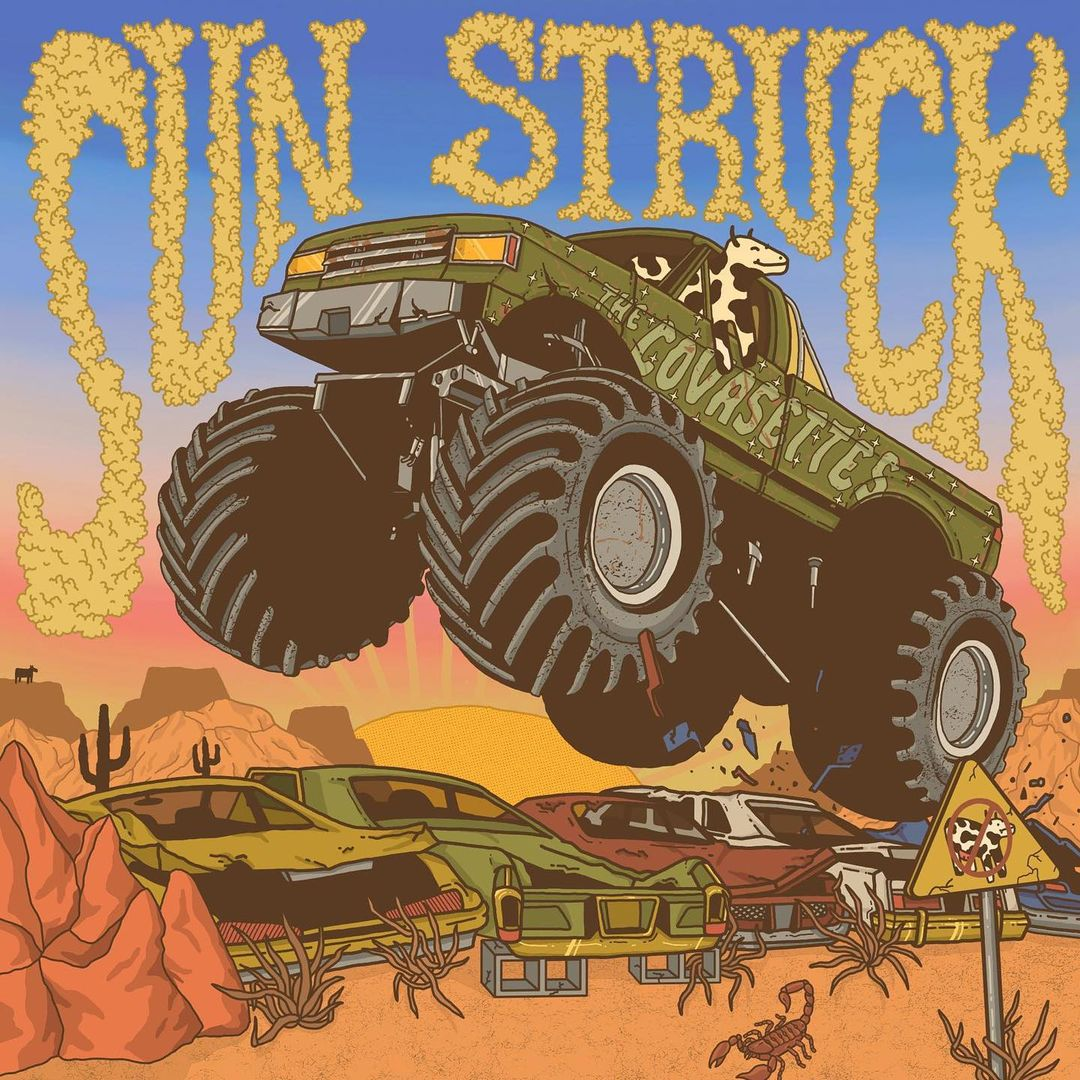 A cartoon cow rides a monster truck over scrap cars in a desert.