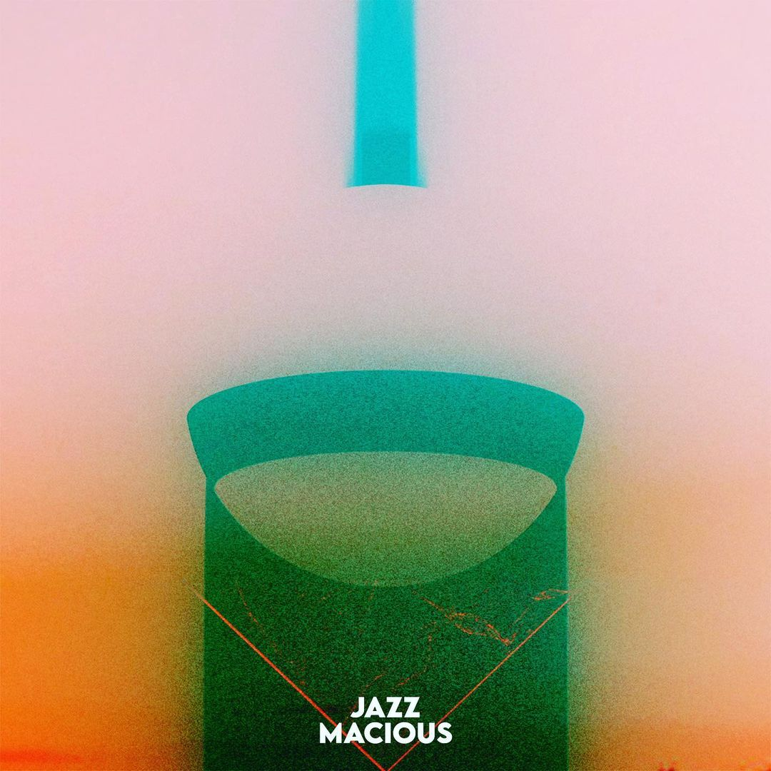 Macious's cover art has abstract shapes with the back colour fading from orange to pink.