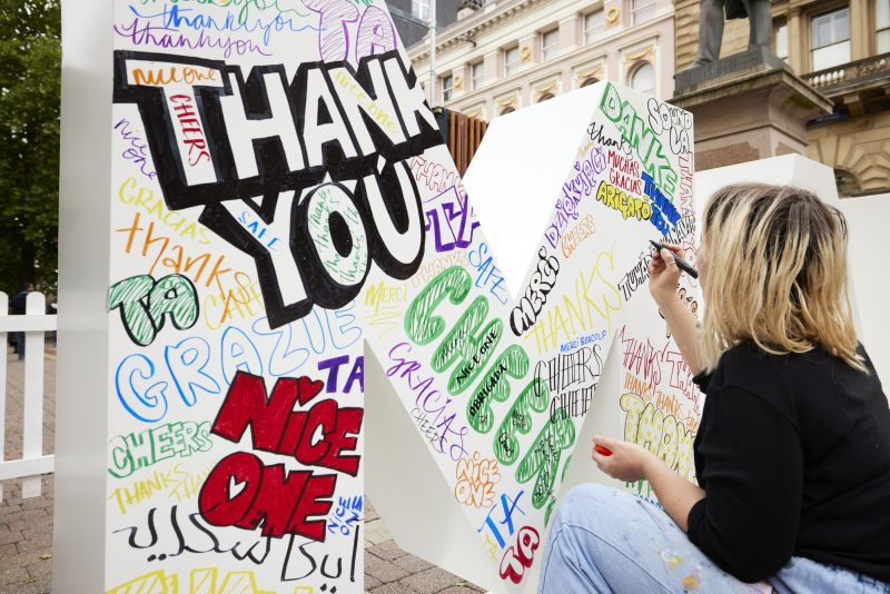 Hundreds queue to fill Manchester Love Letters Wall with thank-you messages, The Manc