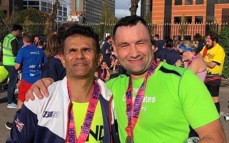 A complete stranger helped a blind runner cross the Manchester Marathon finish line, The Manc