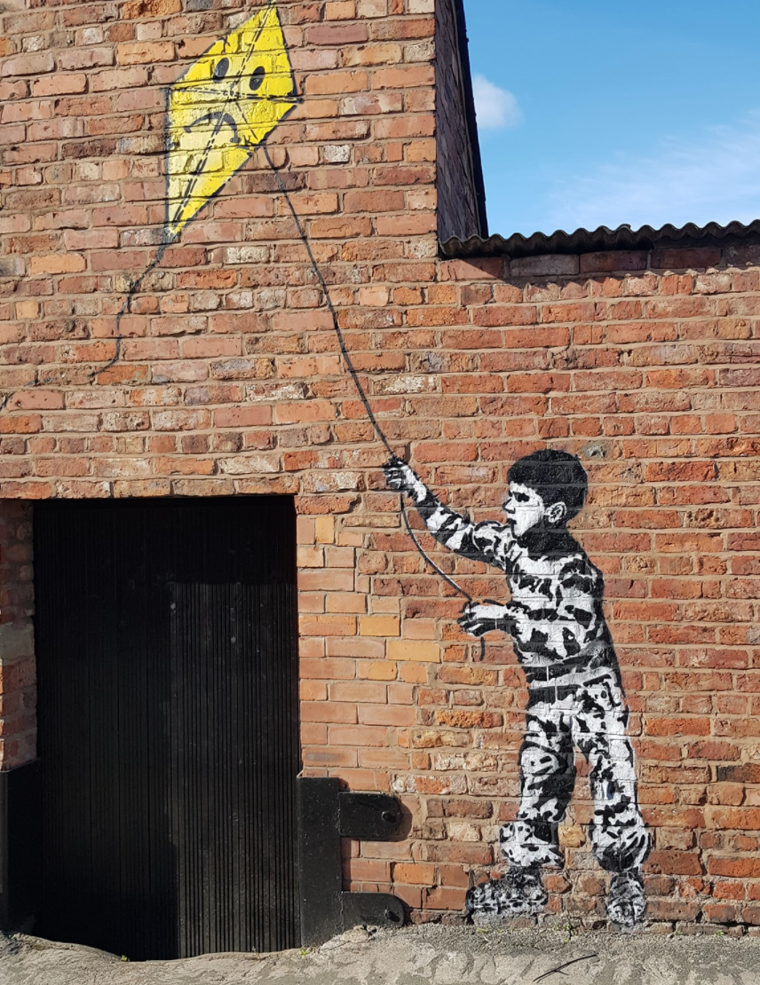 New Banksy-style street art mural appears on the side of a Stockport pub, The Manc